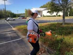 Weed eating at Haven Fellowship Church Workday 2019